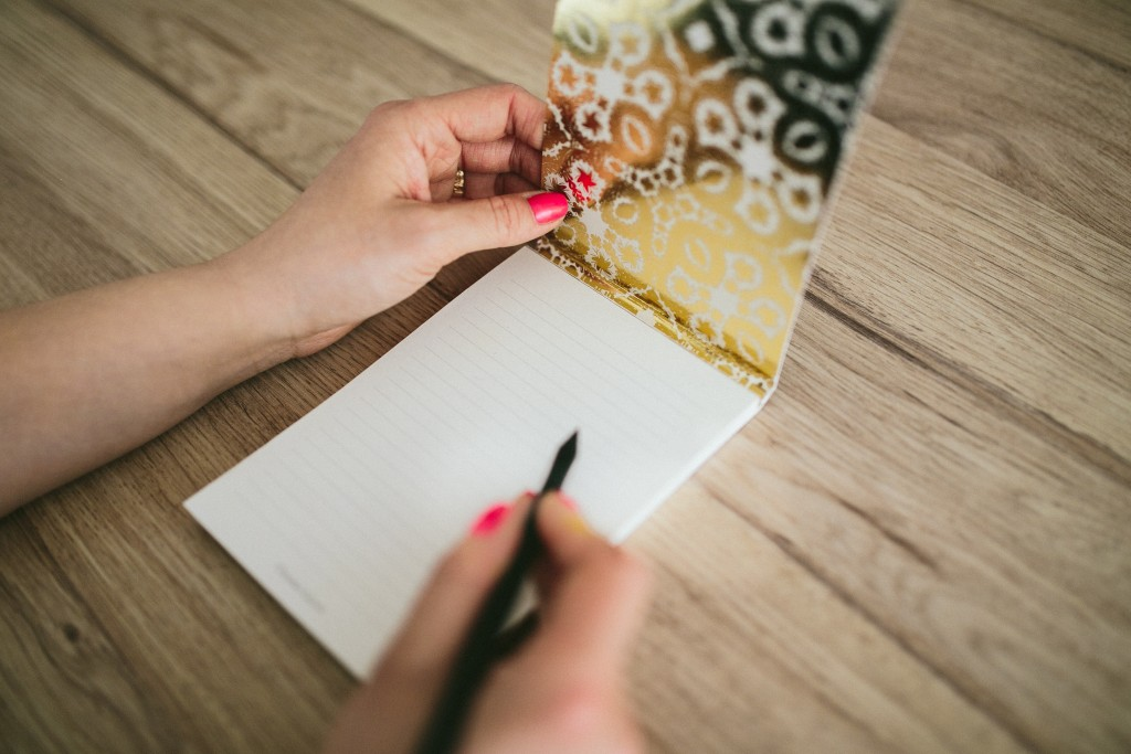 kaboompics.com_Woman writing on notebook (2)